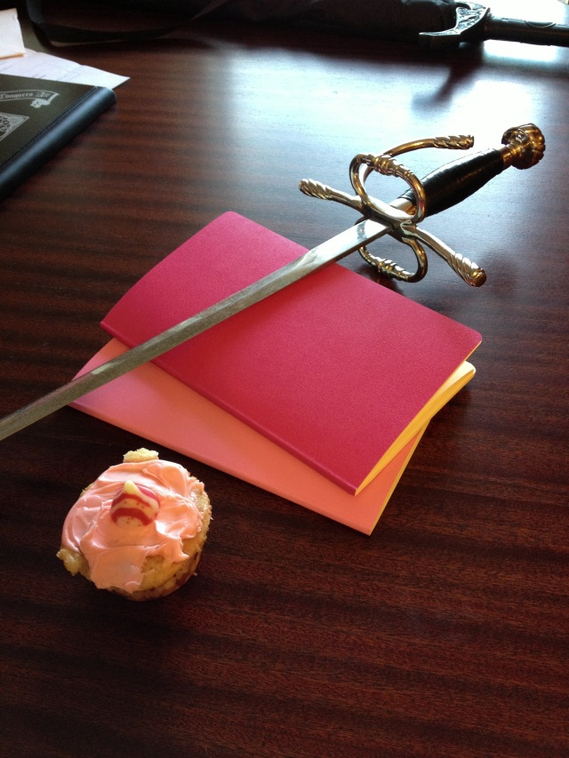 Cupcake, notebooks, and a sword... What else does a girl need?